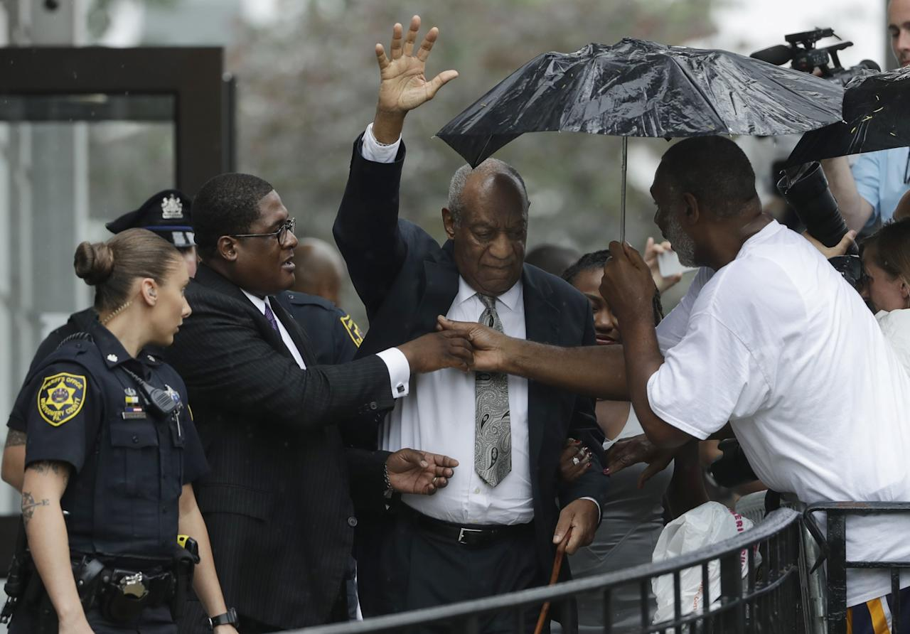 <p>Bill Cosby raises his hand as he exits the Montgomery County Courthouse after a mistrial was declared in Norristown, Pa., Saturday, June 17, 2017. Cosby's trial ended without a verdict after jurors failed to reach a unanimous decision. (AP Photo/Matt Slocum) </p>