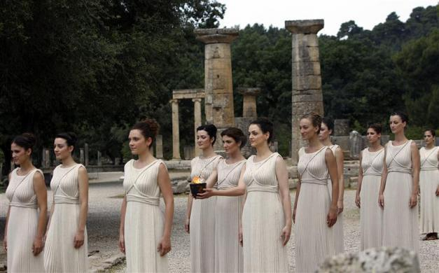 Actresses, playing the role of priestesses, take part in the torch lighting ceremony of the London 2012 Olympic Games at the site of ancient Olympia in Greece May 10, 2012.