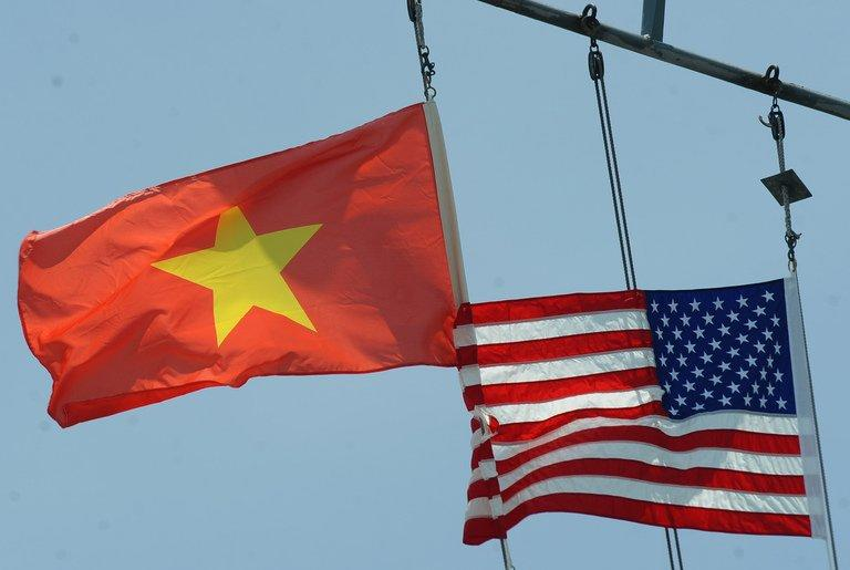 Vietnamese and US flags are seen flying atop a US ship in Tien Sa port, Vietnam in April 2012