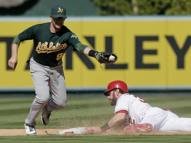 Los Angeles Angels' Josh Hamilton, right, is safe at second under the tag by Oakland Athletics shortstop Jed Lowrie during the eighth inning of a baseball game in Anaheim, Calif., Wednesday, Sept. 25, 2013. The Angels won 3-1. (AP Photo/Chris Carlson)