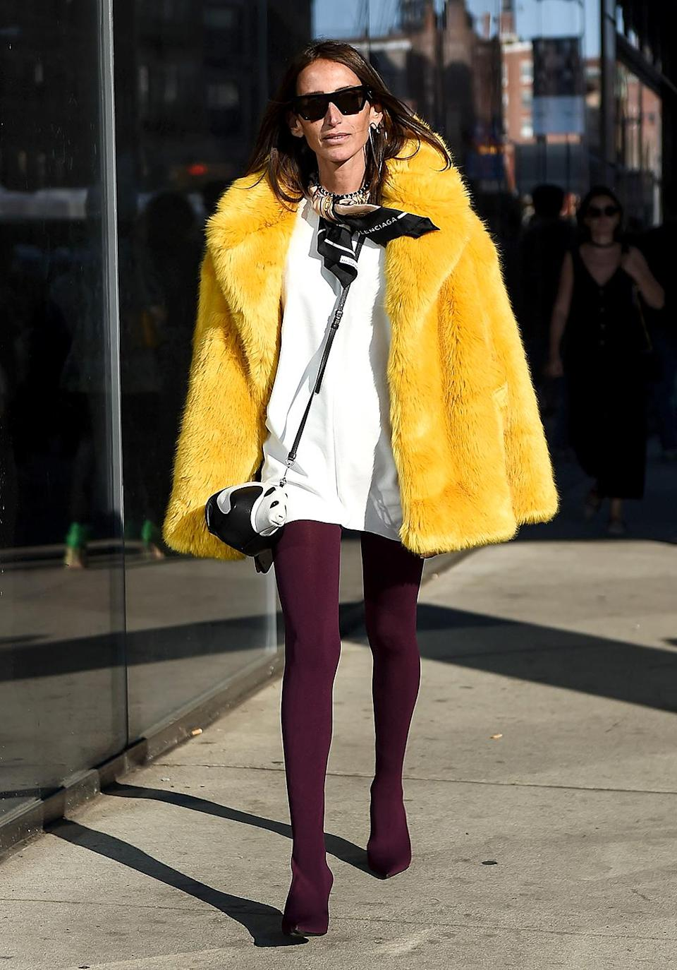 Loulou De Saison bundles up in a yellow fur coat. (Photo: Daniel Zuchnik/Getty Images)