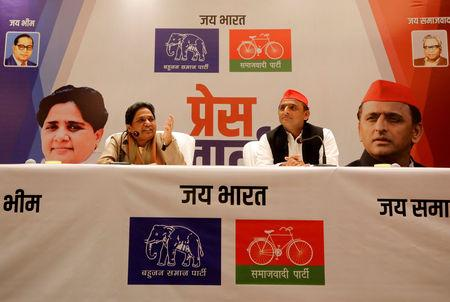 FILE PHOTO: BSP chief Mayawati speaks as Akhilesh Yadav, chief of SP, looks on during a joint news conference to announce their alliance for the upcoming national election, in Lucknow