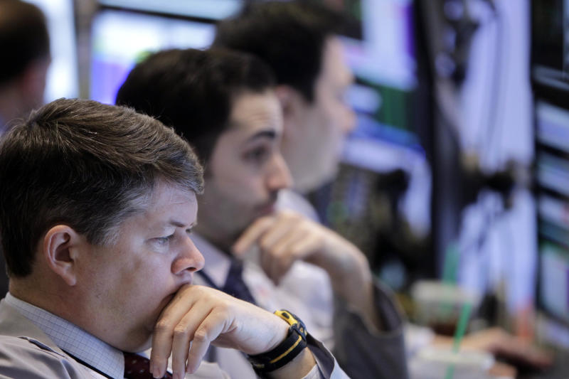 FILE - In this Tuesday, Feb. 21, 2012 file photo, traders work on the floor at the New York Stock Exchange in New York. Stock indexes are edging higher in early trading on Wall Street Tuesday, May 21, 2013, as investors look ahead to the Federal Reserve's next moves. (AP Photo/Seth Wenig, File)