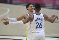 Golden State Warriors' Jordan Poole (3) and Kent Bazemore (26) celebrate after a basket in the second half of an NBA basketball game against the Cleveland Cavaliers, Thursday, April 15, 2021, in Cleveland. (AP Photo/David Dermer)