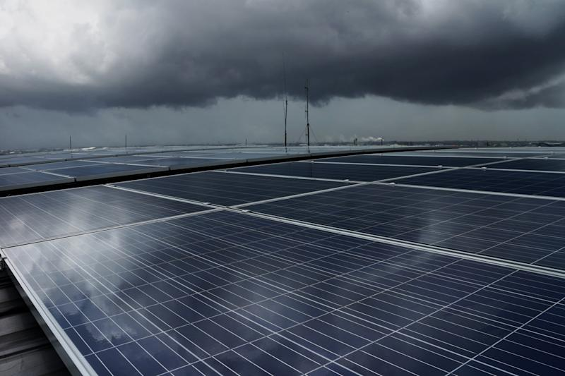 Storm clouds over a solar panel installation