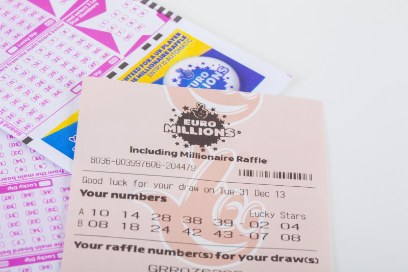 London, United Kingdom - January 07, 2014: A photo of a Euro Millions lottery ticket in the United Kingdom. EuroMillions is a transnational lottery, launched on 7 February 2004 by France's Française des Jeux, Spain's Loterías y Apuestas del Estado and the United Kingdom's Camelot.