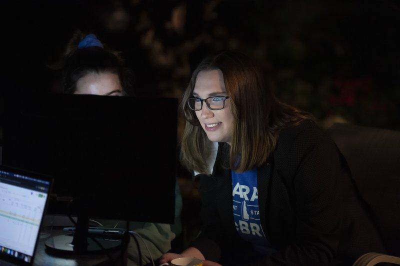 Sarah McBride smiles as she looks at a computer screen. Source: AP