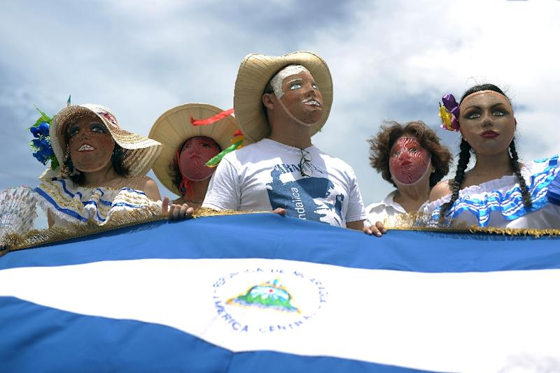 """Nicaraguan opposition protesters take part in a march called """"Masaya florecera"""" (Masaya will flourish) in Managua on July 21, 2018 (AFP Photo/MARVIN RECINOS)"""