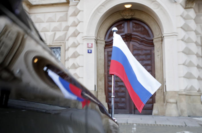 Car of Russia's ambassador to Prague, Aleksandr Zmeyevsky is parked in front of the Foreign Ministry in Prague, Czech Republic, Wednesday, April 21, 2021. The ambassador was summoned by newly appointed Foreign Minister Kulhanek to be handed the Czech protest against the Russian expulsion move, which the Czechs consider disproportionate, saying it has paralyzed the Czech Embassy in Moscow following the fierce diplomatic crisis over allegations that Russian agents were involved in a massive Czech ammunition depot explosion. (AP Photo/Petr David Josek)