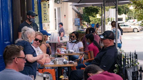 PHOTO: Customers have a lunch outside a restaurant as the city reopens from the coronavirus lockdown, June 15, 2020, in Hoboken, N.J. (Jeenah Moon/Getty Images)