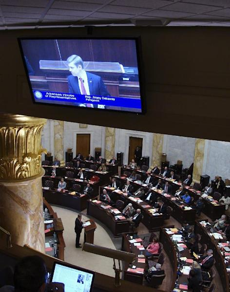 In this March 6, 2017, photo, Arkansas state Rep. Jimmy Gazaway, of Paragould, speaks in the House chamber at the state Capitol in Little Rock for his bill that would prohibit the general release of videotape depicting the death of a law enforcement officer in the line of duty. A recording of a Trumann officer being shot dead in 2011 continues to pop up in social media feeds of the officer's family nearly six years later. The state Senate could vote on the measure as early as Thursday afternoon, March 9, 2017. Gazaway helped prosecute the officer's killer. (AP Photo/Kelly P. Kissel)