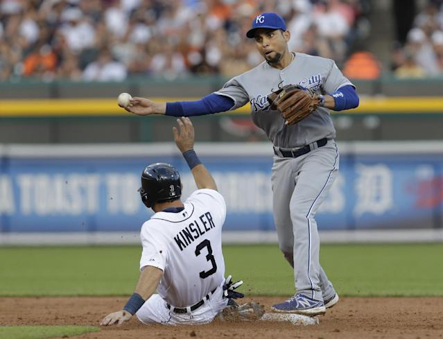 Kansas City Royals second baseman Omar Infante, right, throws to first base to complete a double play as Detroit Tigers' Ian Kinsler, left, tries to break it up on a Miguel Cabrera ground ball in the third inning of a baseball game in Detroit, Monday, June 16, 2014. (AP Photo/Paul Sancya)
