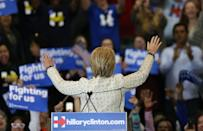 <p>Democratic U.S. presidential candidate Hillary Clinton acknowledges supporters at a primary night party in Columbia, S.C., on Saturday. <i>(Photo: Randall Hill/Reuters)</i></p>