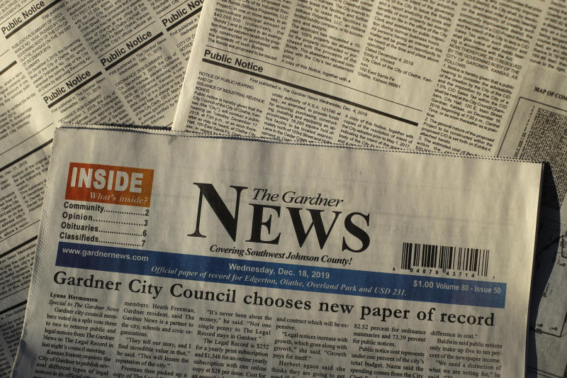The Gardner News, with a front-page story on it's loosing status of the city's paper of record, is seen Friday, Dec. 20, 2019, in Gardner, Kan. The City Council voted to move legal ads to another publication in a nearby city as a cost-saving move only weeks after the city's mayor and a council member accused the paper of publishing inaccurate material. (AP Photo/Charlie Riedel)