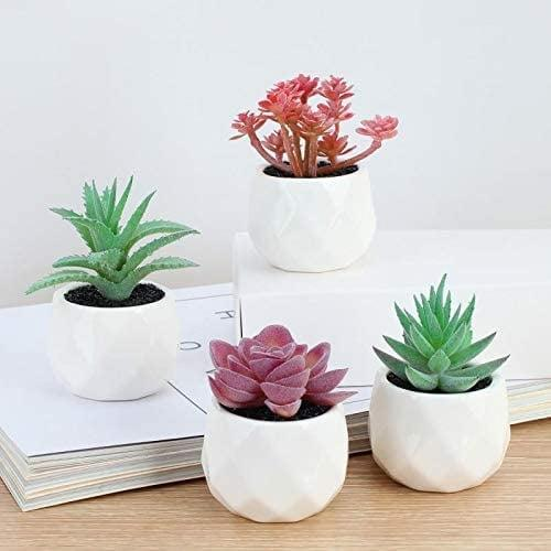 <p>If you need a little more than green in your enviroment these <span>Faux Succulent in White Ceramic Pots</span> ($18) are perfect!</p>