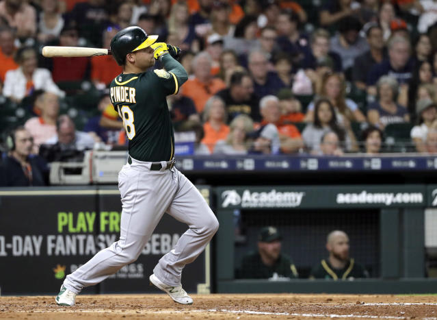 Oakland Athletics' Chad Pinder watches a three-run home run against the Houston Astros during the fourth inning of a baseball game Wednesday, July 11, 2018, in Houston. (AP Photo/David J. Phillip)