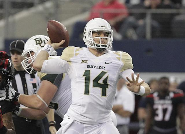 Baylor quarterback Bryce Petty (14) throws against the Texas Tech in the first half of an NCAA college football game, Saturday, Nov. 29, 2014, in Arlington, Texas. (AP Photo/Tim Sharp)