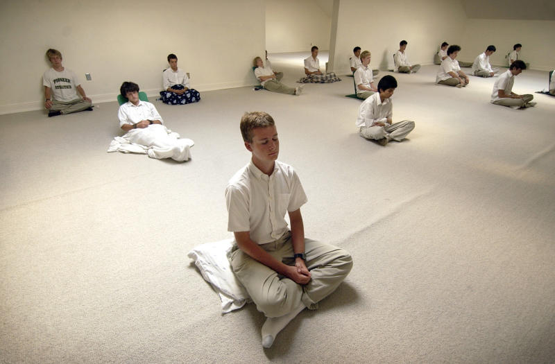 FILE - In this Sept. 14, 2004 file photo, students practice transcendental meditation at the Maharishi School of the Age of Enlightenment in Fairfield, Iowa. A legal dispute between the Iowa-based nonprofit that has taught transcendental meditation in the United States for decades and Thom Knoles, a former associate who left and built his own group of followers, could decide whether the Maharishi Foundation will continue to control teaching or whether rivals can market similar services and benefits without obtaining a license from the Iowa group. (AP Photo/Charlie Neibergall, File)