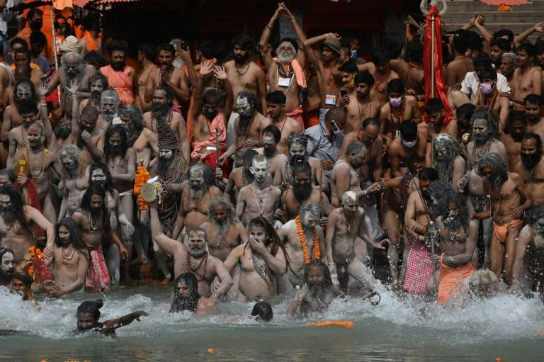 Despite rising virus cases, pilgrims have gathered in huge numbers at the Ganges to take part in the event