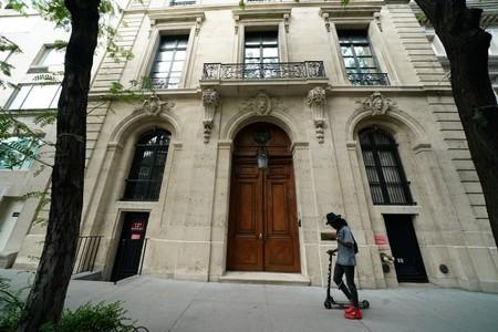 A man walks past the front door of the upper east side home of Jeffrey Epstein in New York
