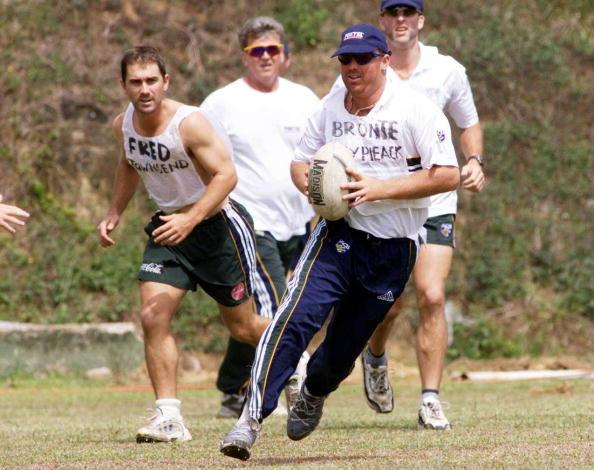 07 Sep 1999:  Shane Warne on the run with Justin Langer following, during a game of Rugby League, during Australian training at Asgiriay Stadium, Kandy, Sri Lanka. Mandatory Credit: Hamish Blair/ALLSPORT