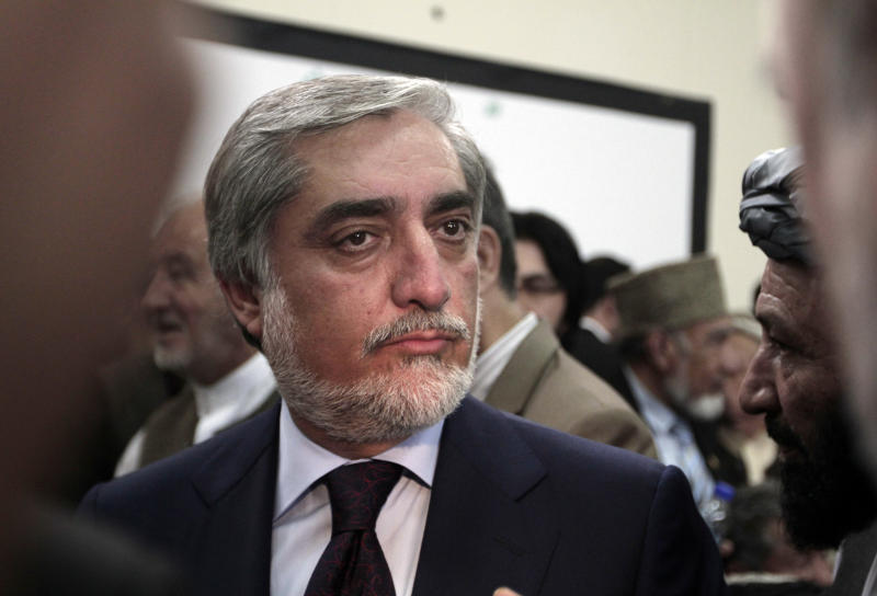 A prominent opposition leader, Abdullah Abdullah, listens to supporters after registering his candidacy in next year's presidential election in Kabul, Afghanistan, Tuesday, Oct. 1, 2013. Next year's presidential election is a key vote that will help determine the success or failure of 12 years of U.S.-led military and political intervention in the country. (AP Photo/Rahmat Gul)