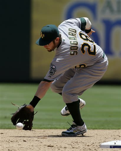 Oakland Athletics second baseman Eric Sogard (28) chases down an infield single by Texas Rangers' Jurickson Profar in the third inning of a baseball game Thursday, June 20, 2013, in Arlington, Texas. (AP Photo/Tony Gutierrez)