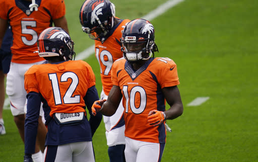 FILE - In this Aug. 29, 2020, file photo, Denver Broncos wide receiver Jerry Jeudy takes part in drills during NFL football practice in Denver. While the Broncos are heading into another lost season, there is one bright spot on the fieldthe team's rookie wide receivers Jeudy and KJ Hamler are excelling in the NFL. (AP Photo/David Zalubowski, File)