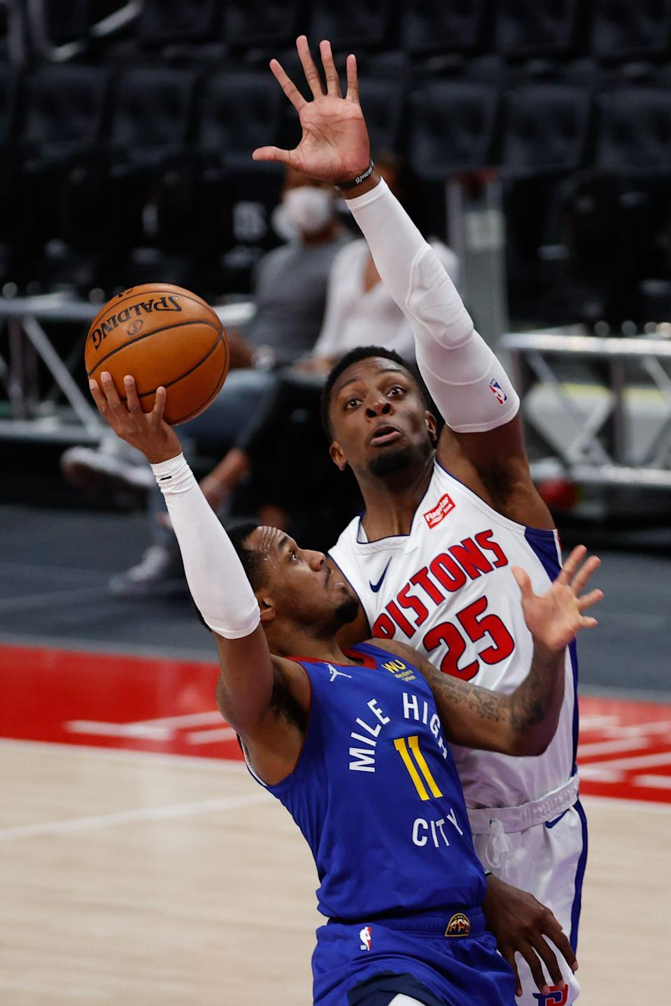 Denver Nuggets guard Monte Morris shoots on Detroit Pistons forward Tyler Cook in the second half at Little Caesars Arena, May 14, 2021.