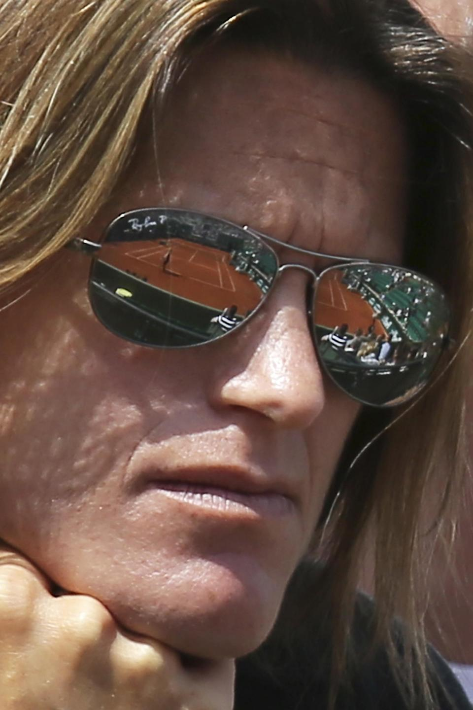 Suzanne Lenglen court is reflected in the sunglasses of Amelie Mauresmo of France who coaches Britain's Andy Murray in the third round match of the French Open tennis tournament against Australia's Nick Kyrgios at the Roland Garros stadium, in Paris, France, Saturday, May 30, 2015. (AP Photo/David Vincent)