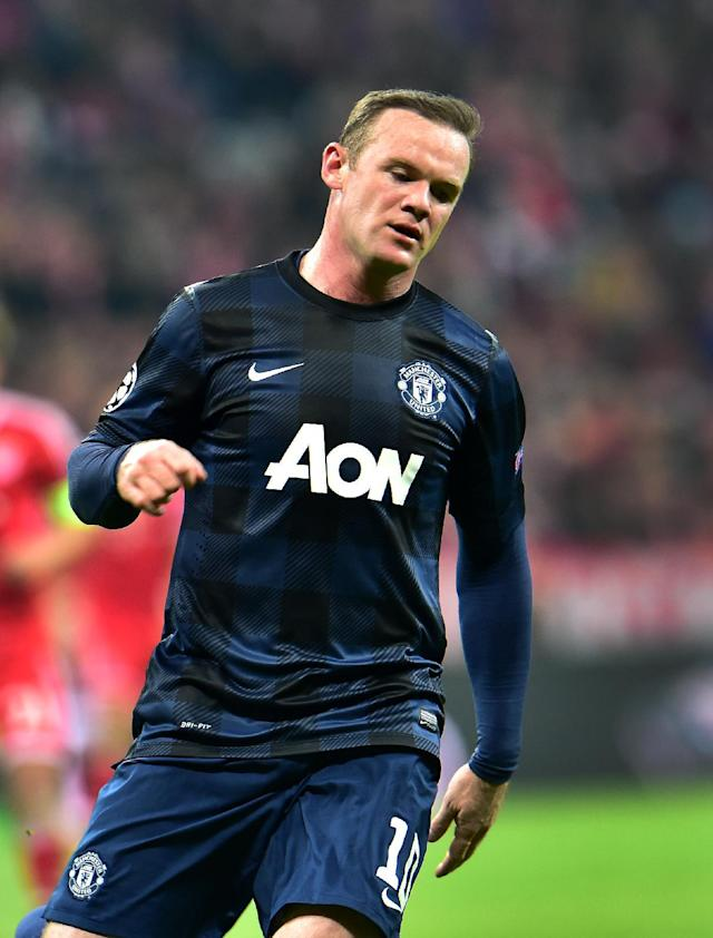 Manchester United's Wayne Rooney looks down during the Champions League quarterfinal second leg soccer match between Bayern Munich and Manchester United in the Allianz Arena in Munich, Germany, Wednesday, April 9, 2014. Munich defeated Manchester by 3:1. (AP Photo/Kerstin Joensson)