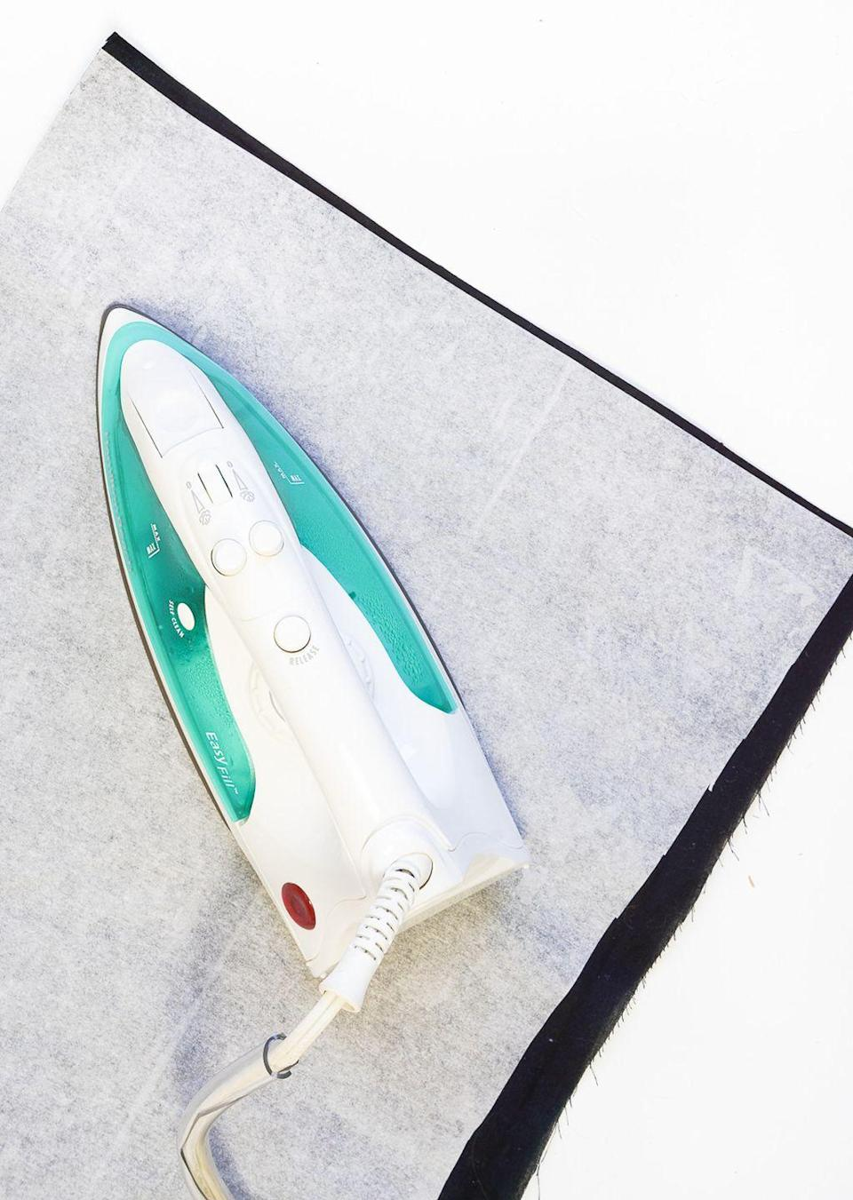 <p>To give your ironing board a little style, upholster it an eye-catching fabric. This is a great way to inject personal style into your sewing studio without bringing in any extra decor that'll take up useable space. </p>