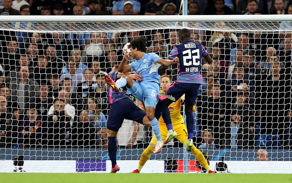 MANCHESTER, ENGLAND - SEPTEMBER 15: Nathan Ake of Manchester City scores their side's first goal during the UEFA Champions League group A match between Manchester City and RB Leipzig - Richard Heathcote/Getty Images