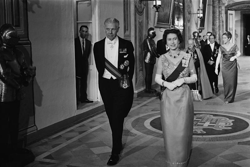 Queen Elizabeth II attends a banquet during a Commonwealth visit to Malta, accompanied by Maurice Henry Dorman (1912 - 1993), the Governor-General of Malta, 14th November 1967.