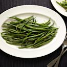 "Prep your green beans quickly; stack a handful of them together on a cutting board and trim the stem ends off the whole stack at once. <a href=""https://www.epicurious.com/recipes/food/views/green-beans-with-zaatar-and-lemon-51258450?mbid=synd_yahoo_rss"" rel=""nofollow noopener"" target=""_blank"" data-ylk=""slk:See recipe."" class=""link rapid-noclick-resp"">See recipe.</a>"