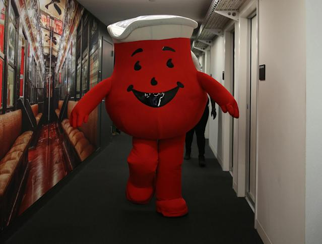 <p>Hey Kool-Aid! The Kool-Aid Man strolls down the hallway with a group of company mascots brought in as interns for the day at Yahoo Studios in New York City on Sept. 25, 2017. (Photo: Gordon Donovan/Yahoo News) </p>