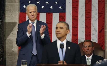 Vice President Biden applauds and Speaker of the House Boehner looks on as President Obama delivers his State of the Union speech on Capitol Hill in Washington