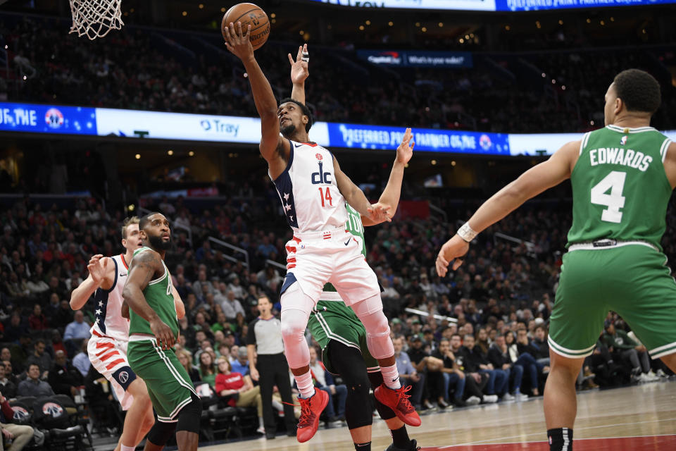 Washington Wizards guard Ish Smith (14) goes to the basket past Boston Celtics guard Carsen Edwards (4) during the first half of an NBA basketball game, Monday, Jan. 6, 2020, in Washington. The Wizards won 99-94. (AP Photo/Nick Wass)