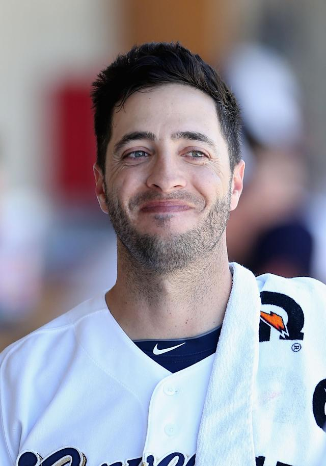 PHOENIX, AZ - MARCH 07: Ryan Braun #8 of the Milwaukee Brewers smiles in the dugout during the spring training game against the San Diego Padres at Maryvale Baseball Park on March 7, 2014 in Phoenix, Arizona. (Photo by Christian Petersen/Getty Images)