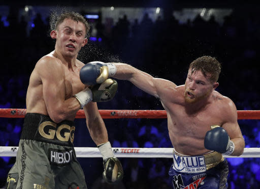 Canelo Alvarez, right, connects with a right to Gennady Golovkin during a middleweight title fight Saturday, Sept. 16, 2017, in Las Vegas. (AP)