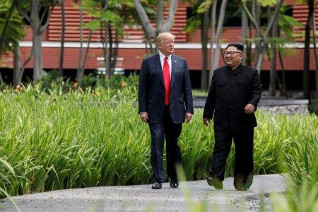 FILE PHOTO - U.S. President Donald Trump and North Korea's leader Kim Jong Un walk together before their working lunch during their summit at the Capella Hotel on the resort island of Sentosa, Singapore June 12, 2018. Picture taken June 12, 2018. REUTERS/Jonathan Ernst