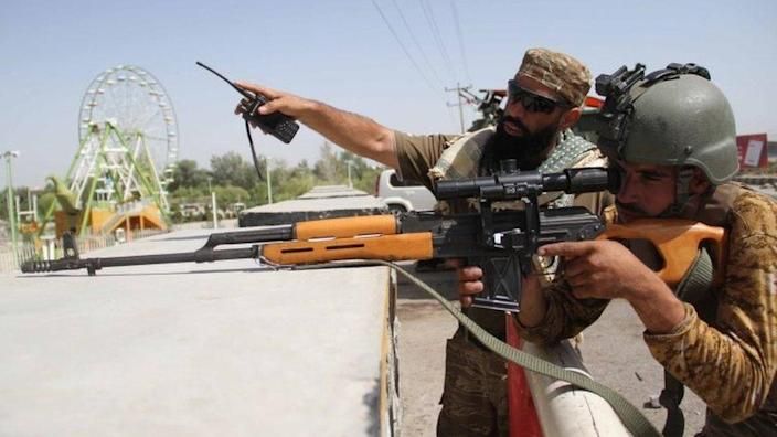 Afghan security officials with gun in Herat (31 July 2021)