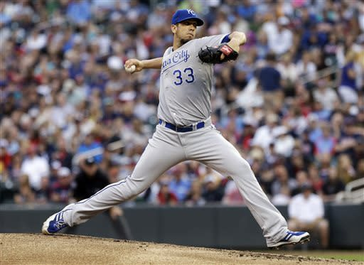 Kansas City Royals' Humberto Quintero throws to a Minnesota Twins batter in the first inning of a baseball game Friday, June 28, 2013, in Minneapolis. (AP Photo/Jim Mone)