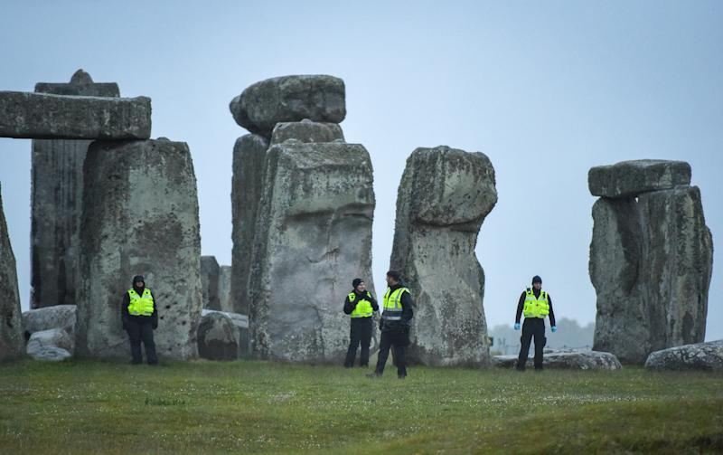 WILTSHIRE, ENGLAND - JUNE 21: Security people guard Stonehenge on June 21, 2020 in Amesbury, United Kingdom. English Heritage, which manages the site, said 'Our priority is always to ensure the safety and well-being of staff, volunteers, attendees and residents. The decision to remain closed for Summer Solstice 2020 was made due to the on-going ban on mass gatherings and the need to maintain social distancing - still the mainstay of measures to combat Coronavirus. Before making this decision we consulted widely with partners, including Wiltshire Council, the police, ambulance services and Avebury Parish Council.' (Photo by Finnbarr Webster/Getty Images)