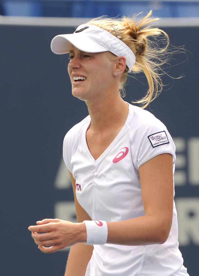 Alison Riske, of the United States, reacts after losing a point during a quarterfinal match against Magdalena Rybarikova, of Slovakia, at the New Haven Open tennis tournament in New Haven, Conn., on Thursday, Aug. 21, 2014. Riske lost the match 7-5, 0-6, 6-4. (AP Photo/Fred Beckham)