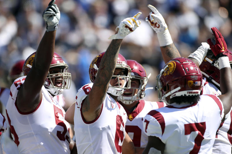 Southern California wide receiver Michael Pittman Jr. (6) celebrates a touchdown with offensive tackle Drew Richmond (53) and running back Stephen Carr (7) against BYU in the first half of an NCAA college football game, Saturday, Sept. 14, 2019, in Provo, Utah. (AP Photo/George Frey)