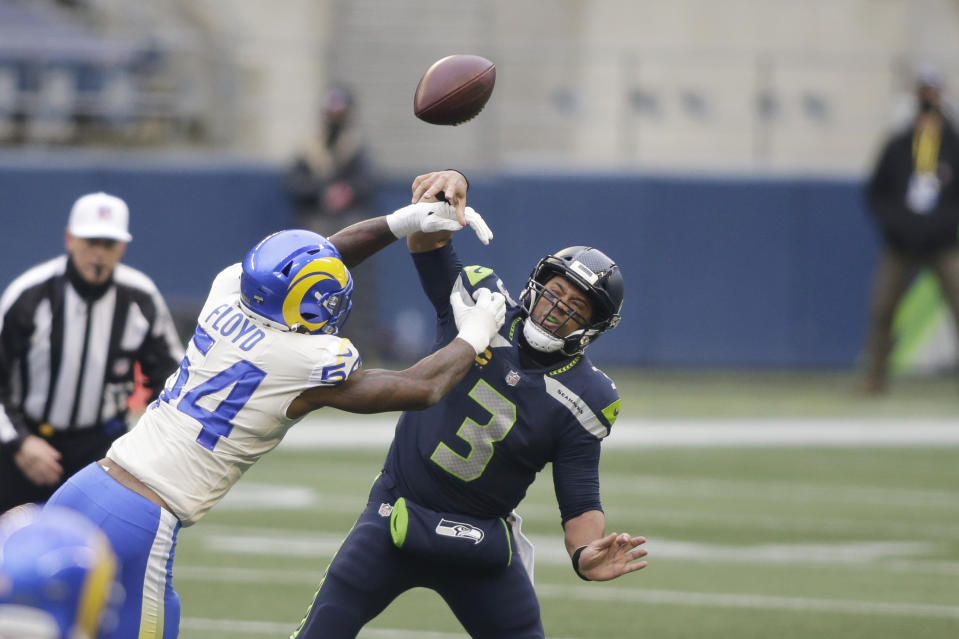 Los Angeles Rams outside linebacker Leonard Floyd (54) knocks the ball away as Seattle Seahawks quarterback Russell Wilson tries to pass. (AP Photo/Scott Eklund)