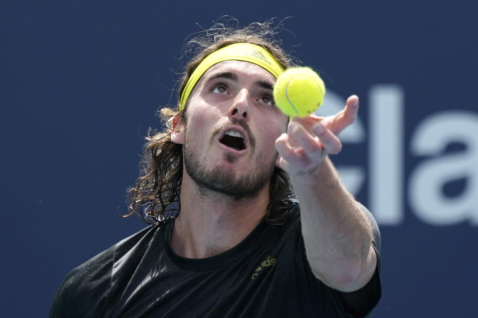Stefanos Tsitsipas of Greece serves to Hubert Hurkacz of Poland during the quarterfinals of the Miami Open tennis tournament, Thursday, April 1, 2021, in Miami Gardens, Fla. Hurkacz won 2-6, 6-3, 6-4. (AP Photo/Lynne Sladky)