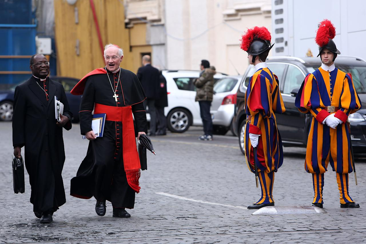 VATICAN CITY, VATICAN - MARCH 07:  Canadian cardinal Marc Ouellet (R) and Archbishop of Kinshasa Laurent Monsengwo Pasinya (L) leave the Paul VI Hall at the end of a session of cardinals general congregations on March 7, 2013 in Vatican City, Vatican.  There is no indication as yet when a Papal conclave will take place following the resignation of Pope Benedict XVI. (Photo by Franco Origlia/Getty Images)