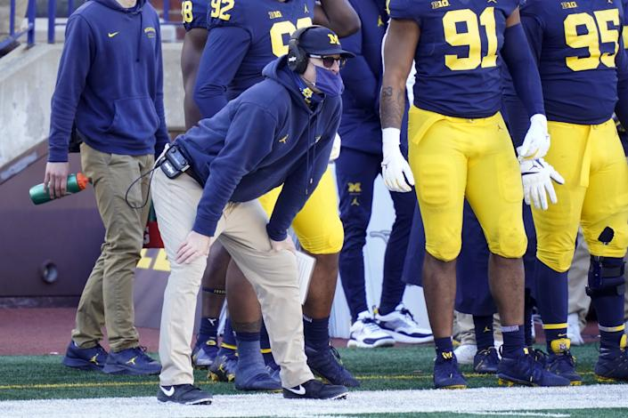 Michigan coach Jim Harbaugh watches from the sideline during the Wolverines' loss to Penn State on Saturday.